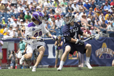 UAlbany LAX midfielder Kyle McClancy vs a Yale player in the 2018 NCAA semifinal