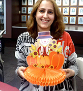 Doctoral student Marzieh Dehghan Chaleshtori shown at last year's Thanksgiving Dinner for international students. She plans to attend again on Thursday evening.