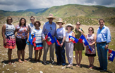 The SUNY team on a recent trip to Haiti includes, Chairman H. Carl McCall and Chancellor Kristina Johnson (center, in straw hats) and CID's Heather Senecal, in green dress. (Photo courtesy of SUNY)