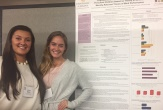 Erica Shudt and Tara Caemmerer, undergraduate human development majors, presenting research