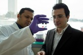 Mehmet Yigit and graduate student researcher Muhit Rana examine a sample in order to detech Ebola Virus biomarkers.