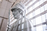 Photopgraph of white minerva statue from science library lobby with window wall in background