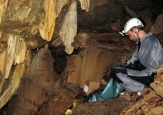 Exchange student Valdir Novello exaimines deposits found in Brazilian caves.