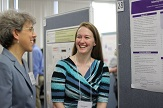 Picture of Associate Dean for Academic Affairs conversing with Student at Annual Poster Day