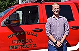 Erik Augspurger standing in front of a Niskayuna Fire District 2 truck