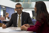 Prof Sanjay Goel chats with a UAlbany student