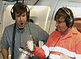 Mark Beaubien, (left) of Yankee Environmental Systems, and Lee Harrison, of the University at Albany, prepare to dispense a soda-can sized dropsonde from NASA's DC-8 flying laboratory.