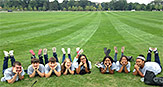World of Psychology students laying on the lawn.