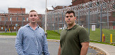 Ph.D. students Tyler Bellick and Andrew Thompson stand outside Albany County Jail