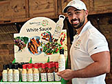 Jamal Rasoully in front of Sauce Display