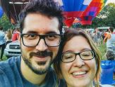Charalampos Chelmis and his wife, Daphney-Stavroula Zois, in front of hot air balloons at the Adirondack Balloon Festival in September 2017.