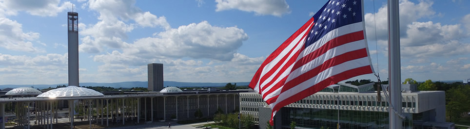 American Flag flying above campus