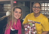 UAlbany softball students wrap presents for the Adopt-a-Family program