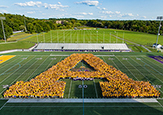 "UAlbany's Class of 2021 and new transfer students form a giant ""A"" on Bob Ford Field."