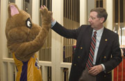 The University's mascot Lil' D congratulates President Hall on his arrival.