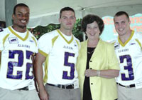 President Karen Hitchcock and UAlbany football players enjoy last year's polo event in Saratoga Springs.