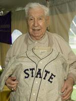 Vince Gillen '41 checks out his old baseball uniform.