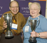 Mel Horowitz '61 and Jacquelyn Gavryck '51 celebrate winning this year's Alumni Weekend attendance and membership cups.