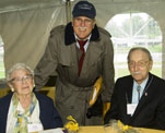 Carolyn Viall and Herbert Bailey, both members of the Class of '36, visit with University Archivist Geoff Williams.