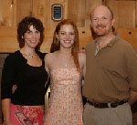 Jill, Erin '04 and Kenneth Lein '79 enjoy a moment together at the 2004 Precommencement Dinner.