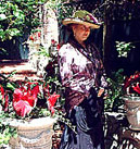 Mary Ellen Shevalier, shown here in a Saratoga Springs garden, plays the elder Marietta Holley in the WPBS documentary.  Kate Winter made Shevalier's hat.