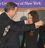 Carol Gilligan receiving Ualbany Medallion from President Hall.