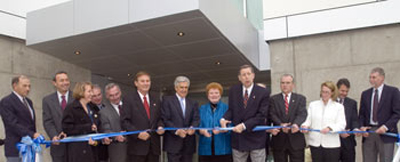 President Hall and group in a symbolic ribbon-cutting for the new UAlbany facility.