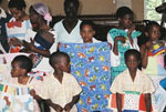 A group of orphans in Zululand, South Africa, enjoy hand made quilts donated by students on the 2006 Summer Study Tour.
