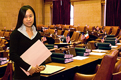 UAlbany student, Donna Yee working in the New York State Assembly chamber