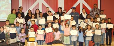 Nakia Hamlett with readers in the after-school program