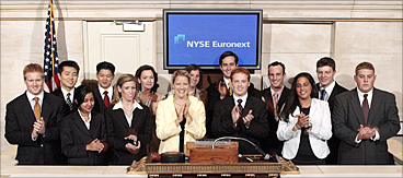 Interns ring the closing bell at the New York Stock Exchange