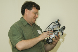 UAlbany Professor Kevin Knuth with a robot built from LEGOs. (Photo Mark Schmidt)