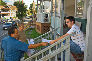 College of St. Rose Safety/Security Officer David Mankad and Pine Hills Neighborhood Association representative Marggie Skinner hand out flyers to residents
