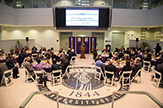 Photo from President's Breakfast in the atrium of University Hall. 80 participants are seated as University President Havidán Rodríguez speaks at podium.