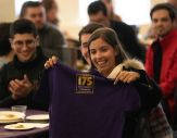 IBS student holds up a UAlbany T-shirt.
