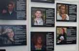 Wall posters show photos of students with information about them