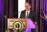 President Havidan Rodriguez speaks from a podium