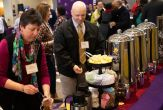 University employees help themselves to coffee and tea at the breakfast reception