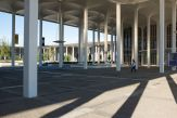 The tall white pillars and arched roof sections of the academic Podium at UAlbany's Uptownn Campus