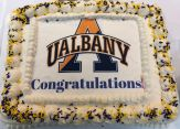 "A cake with the UAlbany logo and the word ""Congratualtions"""