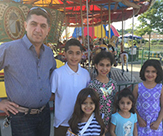 Pictured: Zeyad Alsaadi, an Iraqi refugee, standing with his five children.