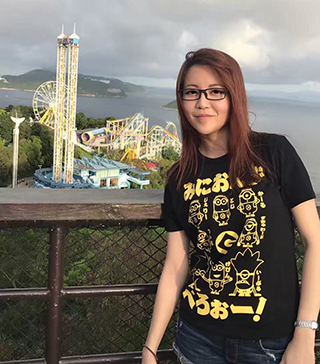 Lin Zho pauses on a hiltop overlooking Ocean Park in Hong Kong in 2017