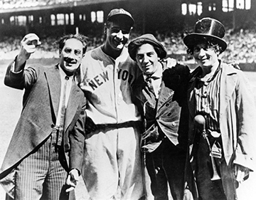 Lou Gehrig, in uniform at the Stadium, poses with the Marx Brothers (in their uniforms)