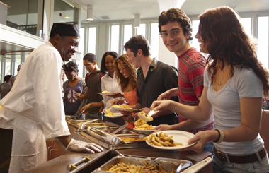 UAlbany students laughing while in line for food at the dining hall