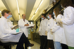 W. Mark Dale training students in the lab.
