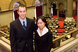 UAlbany student interns Richard Paladino and Donna Yee in the Assembly chamber