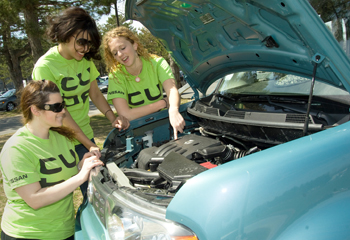 UAlbany students look under the hood of a Nissan cube car.