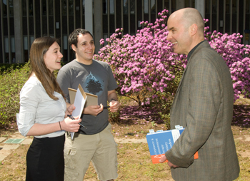 Clinical psychology students Andrea Hobkirk and Ari Rabkin with Associate Professor John Forsyth.