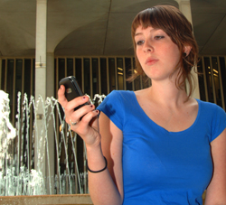 UAlbany student receiving a text message.