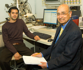 Nanosciences professor Hassaram Bakhru seated with graduate student